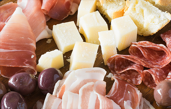 An assortment of deli meats, cheeses and olives